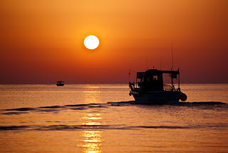 fishing boats, sunset